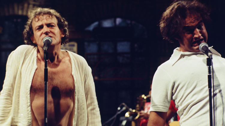 Joe Cocker performs with John Belushi on Saturday Night Live on Oct. 2, 1976.