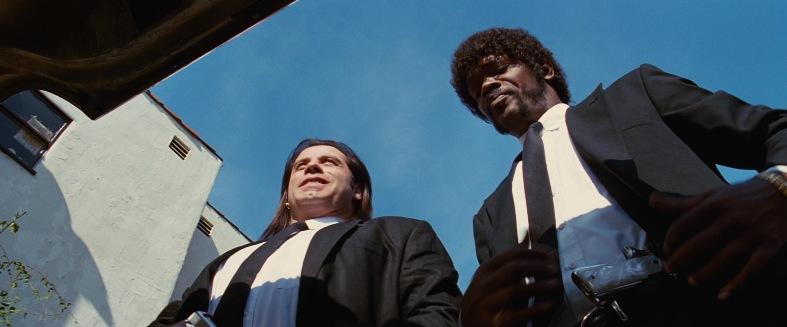Pulp Fiction citazioni e dialoghi della pellicola di Quentin Tarantino, John Travolta, Vincent Vega e Samuel L. Jackson, Jules Winnfield, aprono baule macchina