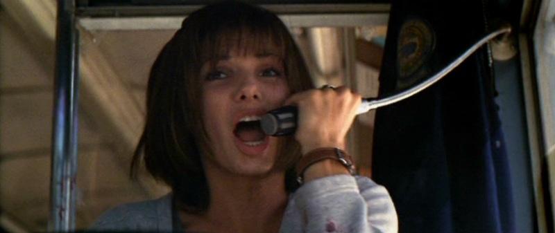 Speed citazioni e dialoghi di Jan de Bont con Keanu Reeves, Dennis Hopper e Sandra Bullock, microfono bus